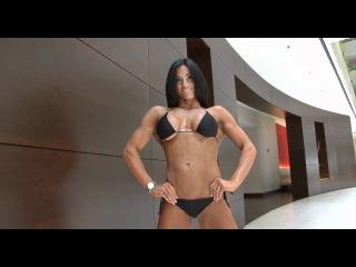 Gorgeous fitness brunette Goddess flexing her cute muscles in black bikini