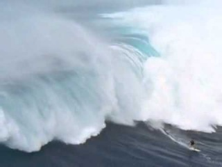 Surfing a Tsunami - Man surfs 65' killer wave - has the ride of his life survives JAWS MAUI