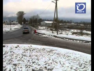 Улица Кныша в Гатчине: снег есть, асфальта нет