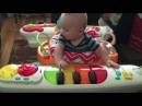 Sebastian playing with his Fisher-Price 4-in-1 Step 'n Play Piano