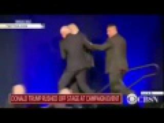 Служба безопасности экстренно увела со сцены кандидата в президенты США Дональда Трампа