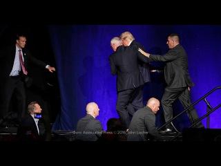 Охрана увела Трампа со сцены из-за вооруженного человека в зале: видео
