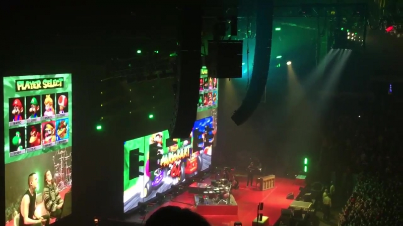 Tyler playing Mario kart with a fan
