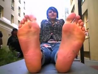 Punk girl sweaty bare feet and soles