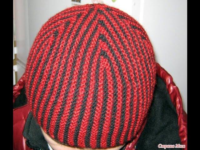 Вязаная шапочка спицами в полоску. Knitted hat with stripes.