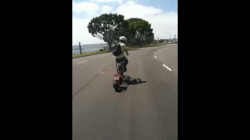 Motorized bike trailer pushes bike 35 mph