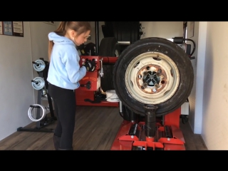 little girl changes 19.5 tire on Hunter TCX625HD