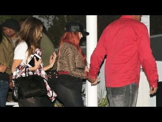 Red-Haired Christina Aguilera An Leopard Print Jacket At Drake Concert