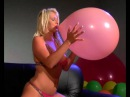 angel blows a pink balloon to pop
