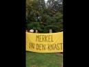 Aktivisten gegen den Besuch von Angela Merkel beim Deutschlandtag