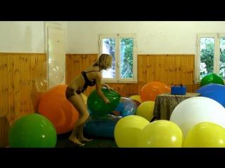 Girl burst big balloons