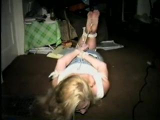 Hogtied on floor