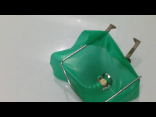 Кламп с платком на рамке одевается на зуб