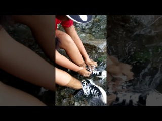 Wetlook - Anna has fun in river with black converse!