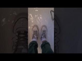 Giulia in bathtub with Nike and white socks