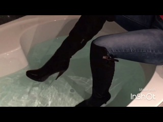 Girl with overknees boots in the bathtub, fully clothed - wetlook