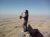 Батырхан Шукенов играет на саксофоне