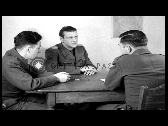 German Colonel Otto Skorzeny interrogated by a US Army captain in Germany; discus...HD Stock Footage