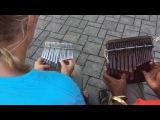 Moyo and Jeannine play Phumvu on the mbira