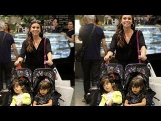 Giovanna Antonelli curte as filhas gmeas no shopping