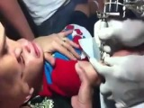 Abuse: Mother Giving Her Baby Boy A Tattoo!