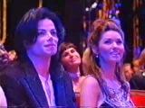 Даяна Росс сидит на коленях У МД на World Music Awards 1996