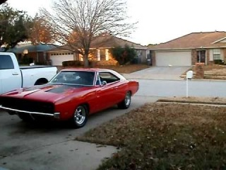 1969 Dodge Charger 440 R/T cruising red with black stripe