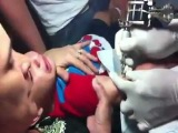 Video  Abuse  Mother Giving Her Baby Boy A Tattoo!.