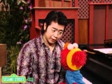Sesame Street: Lang Lang and Elmo Exercise To Music