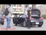 A dude wears yoga pants to prank some guys as they walk by checking him out
