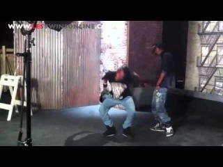 Les Twins Larry Laurent dancing in front of Cityscape for BET