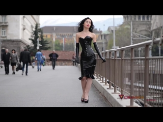 Black Latex Gloves and Skirt and a PVC corset. Walking in the city center