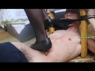 Two rich asian women, amuse themselves in a hotel room, by trampling a young slave