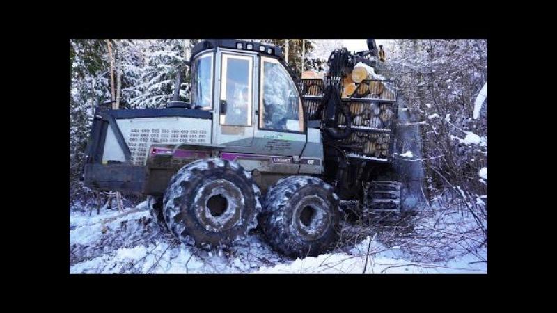 Forwarder Logset 6F logging in beautiful snowy winter forest