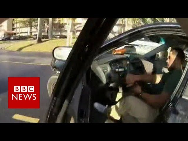 US police officer's bodycam records him clinging to speeding car - BBC News