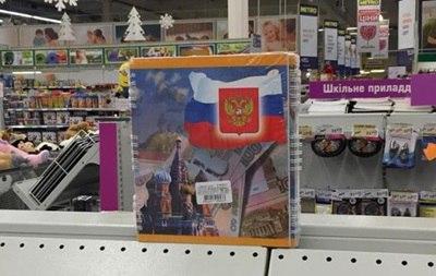 Радикалы в Днепре разбили витрину магазина из-за тетрадей с символикой России