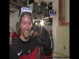 Jaromir Jagr gives Claude Giroux a poke in the back during the post-game interview.