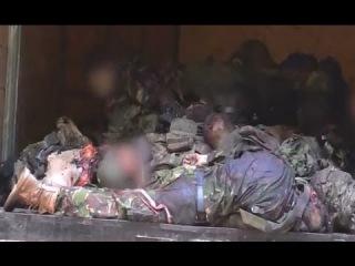 Донецк. Тела убитых при обстреле КамАЗа с ранеными привезли в морг +18 27.05.2014