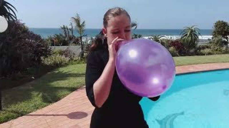 Girl blow to pops purple balloon at swimming pool and hurts her ears