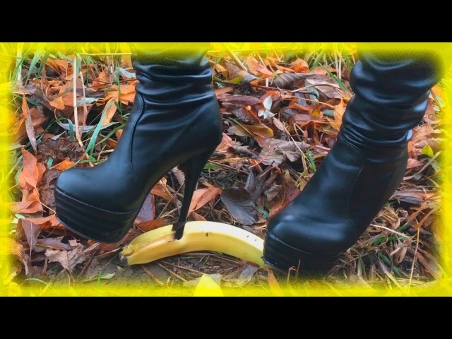 Bananas crushed under high boots with high heels and platforms