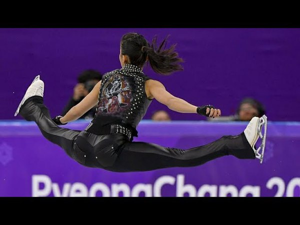 Hungarian ice skater Ivett Toth performs to AC DC throws rock horns at Winter Olympics