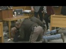 Father of victims lunges at Larry Nassar in court