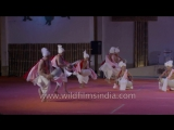 Manipuri folks play Pung (drum) and dance at the same time