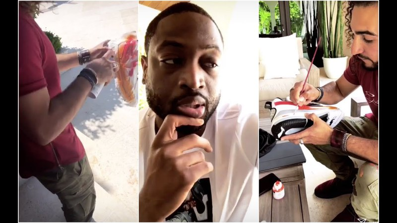Dwyane Wade brings in an artist to add some custom designs to his shoes