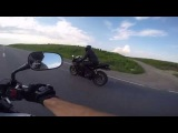 Motorcycles drag races, wheelies, exhaust sounds. 3.0