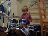 2 year old kid drummer LOGAN ROBOT GLADDEN playing and singing Queen We Will Rock You