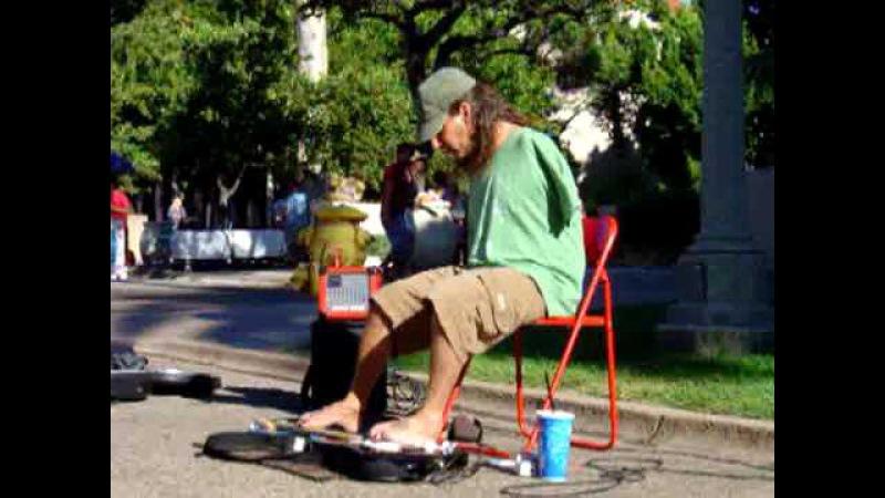 Mark Goffeney shredding blues on guitar with his feet. San Diego's Big Toe Band