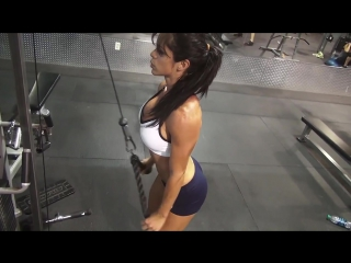 Intense arm workout at gym- female fitness model michelle lewin