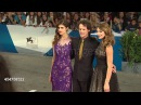 Ashley posing on the red carpet with Anton Yelchin and Alexandra Daddario at the 'Burying The Ex' Premiere