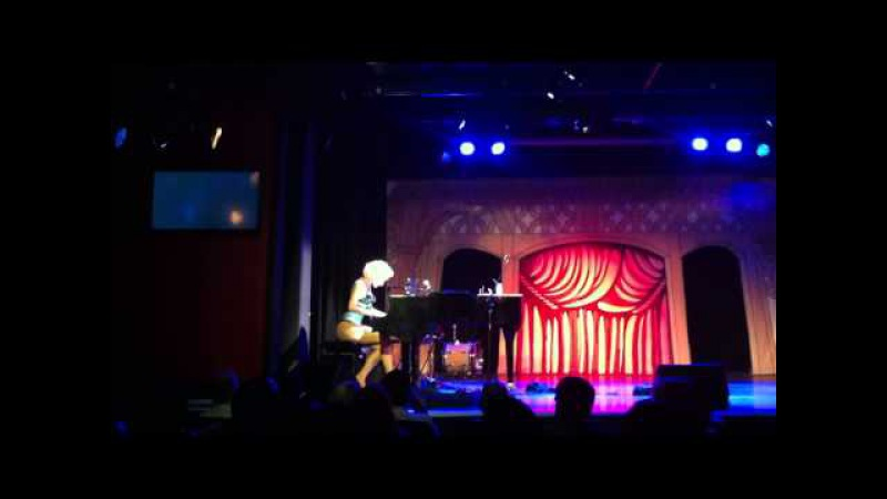 Chrys Columbine performs Naked Nocturne Piano Strip at London's Leicester Square Theatre
